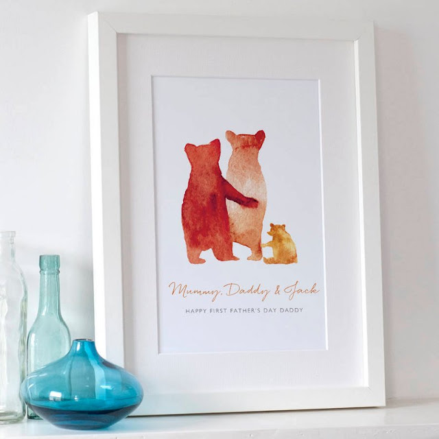 An image from the Etsy shop selling Family bear prints showing a framed print with orange watercolour style bears and text underneath saying: Mummy, Daddy & Jack. Happy First Father's Day Daddy