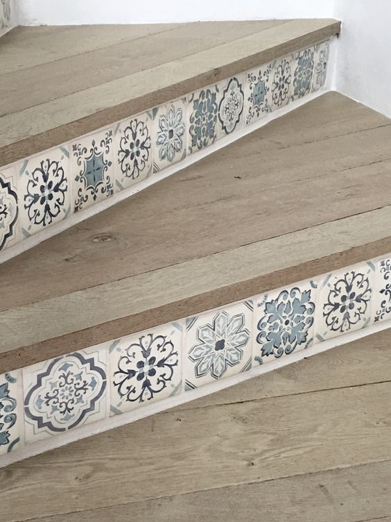 Blue and white beautiful handpainted tile on stairs in Giannetti Home's project on Hello Lovely Studio