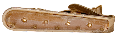 A vintage man's tie clip in gold, with small gold stars on the face.
