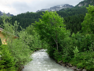 Fast-flowing River Simme, heading upstream toward the mountains, Lenk, Switzerland
