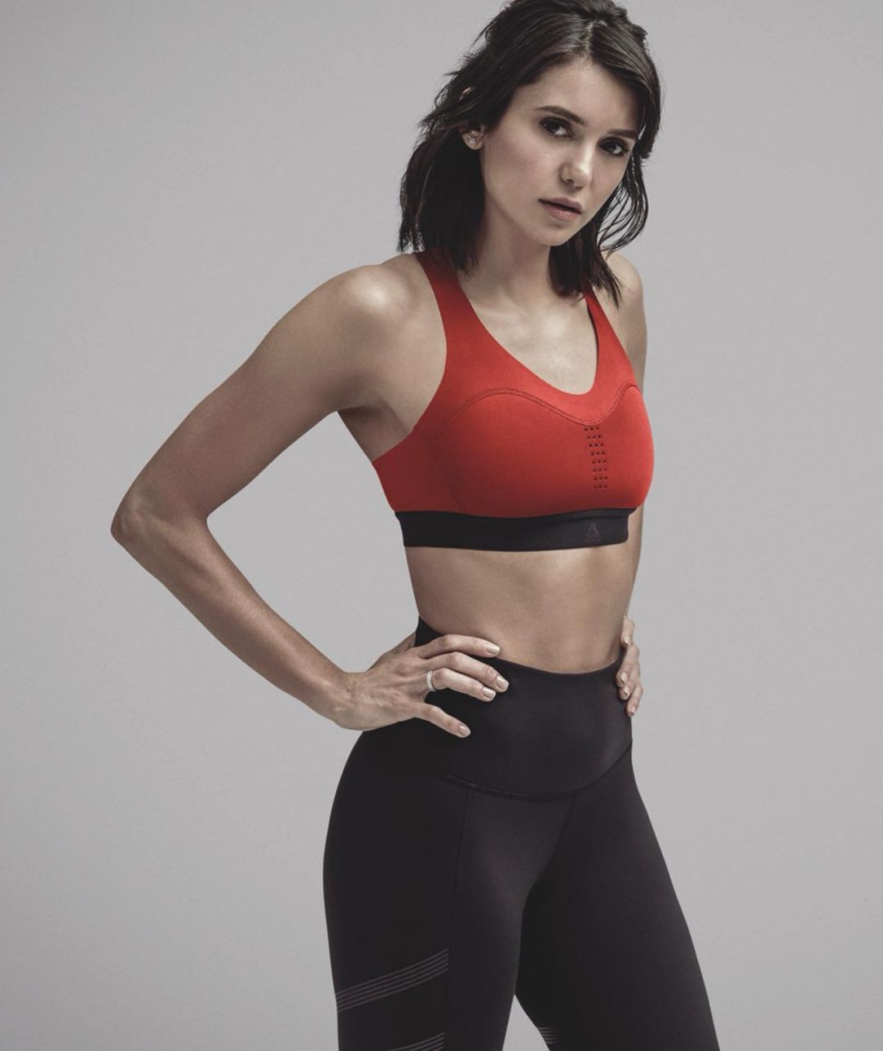 Nina Dobrev Flaunts Curves In Sexy Sports Bra