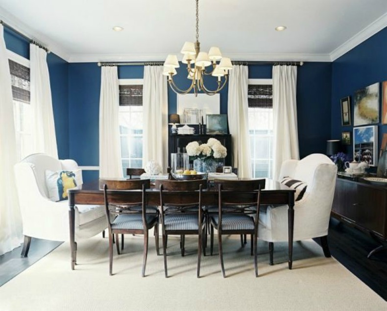 Navy blue walls, white drapes, coastal dining room, white slipcover chairs