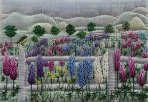 scene of a field of lupine flowers and a mountain background
