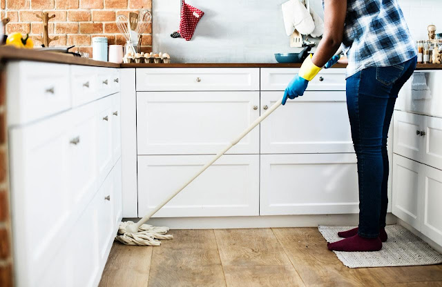 Person mopping floor via Pexels.com