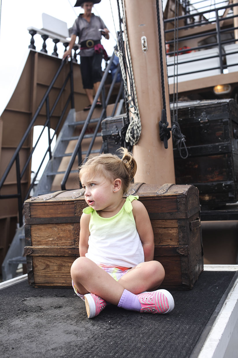 Little girl on board the Black Raven Pirate Ship