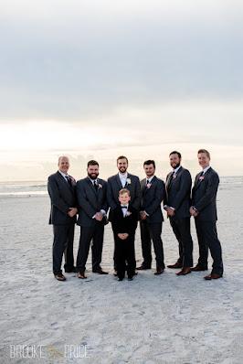 groomsmen in tuxs and ringbearer