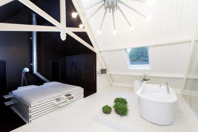 Picture of modern bed and white bathtub