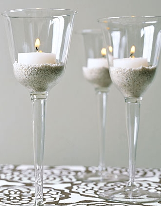 wine glasses with sand and candles