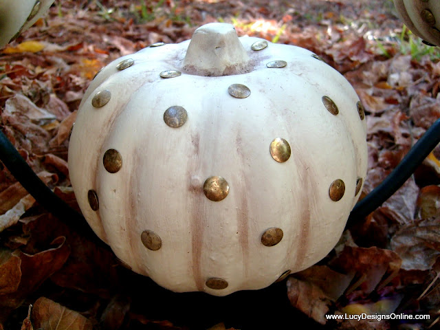 dollar store Halloween pumpkins with thumbtack studs