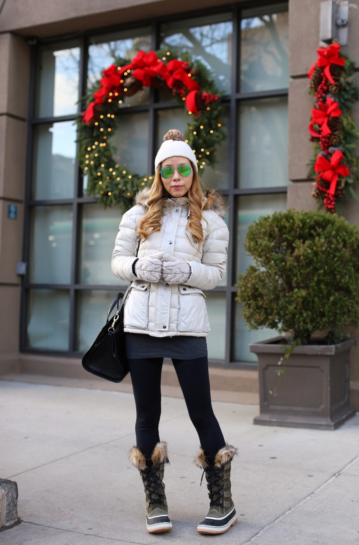 white down jacket, leggings, sorel snow boots, rayban reflective sunglasses, gloves, alexander wang bag, snow day outfit, cold weather day outfit, winter essential, winter outfit,j crew pom pom beanie