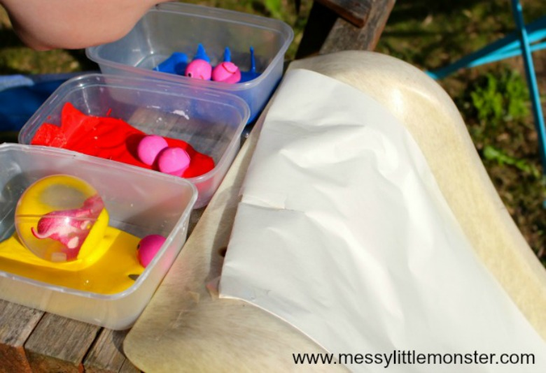 paint rolling on a slide - a fun outdoor art idea for kids