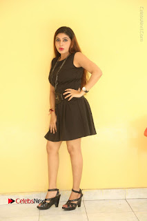 Tollywood Upcoming Actress Pooja Roshan Stills in Black Short Dress at Plus 1 Movie Trailer Launch  0231.JPG