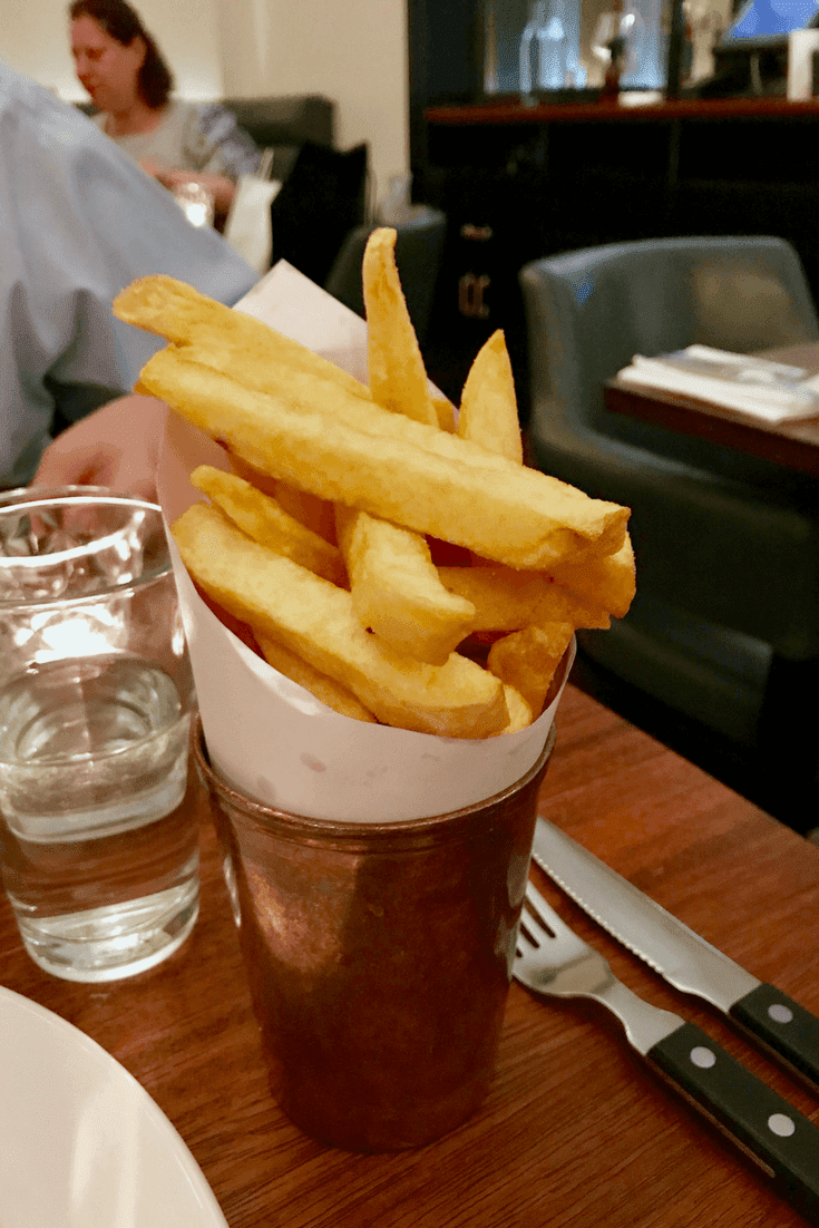 chips, arranged in a tall brass glass