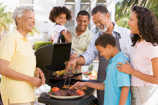 Photo of a Family Barbecuing