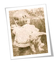 Author as a child with favourite teddy