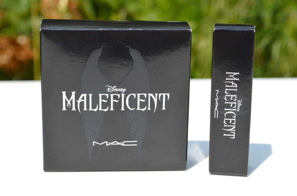 Image of two products from the MAC Maleficient collection with a lipstick and highlighter inside their packaging