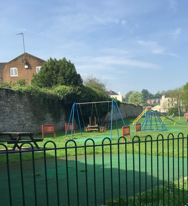 playground with slide, climbing frame and swings