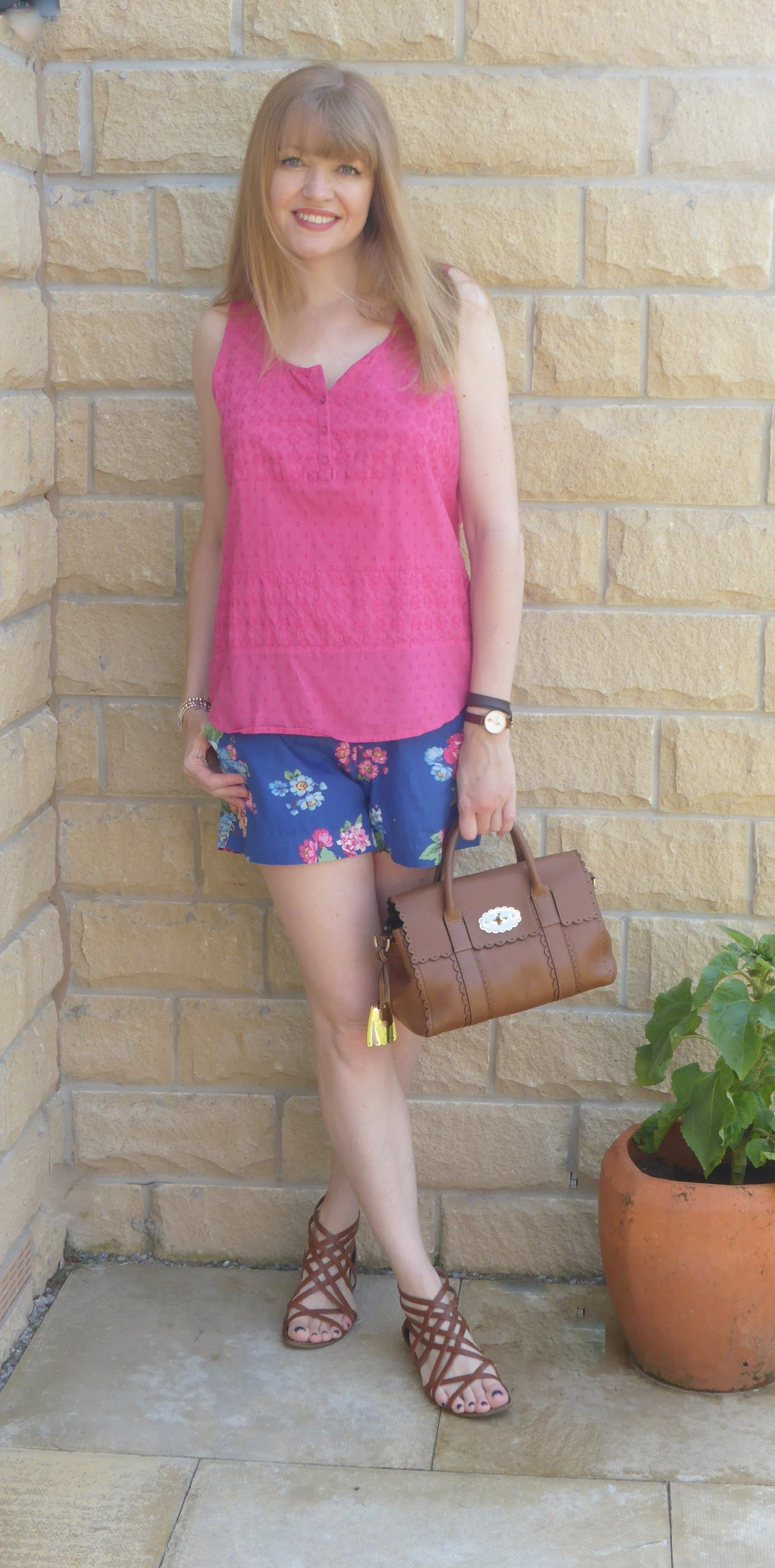 Over 40 blogger What Lizzy Loves wears blue floral Joules shirts with bright pink top and tan leather gladiator sandals