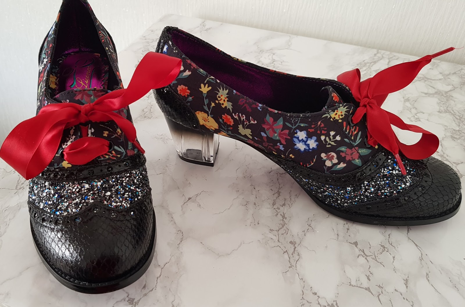 Image showing black and red womens shoes decorated with patterns and sparkles and clear perspex heels. By Poetic Licence.