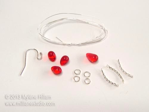 Christmas red teardrop beads, curved silver connectors and jewellery findings needed to make Chain of Lights earrings.