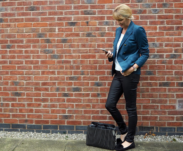 teal blazer with black jeans
