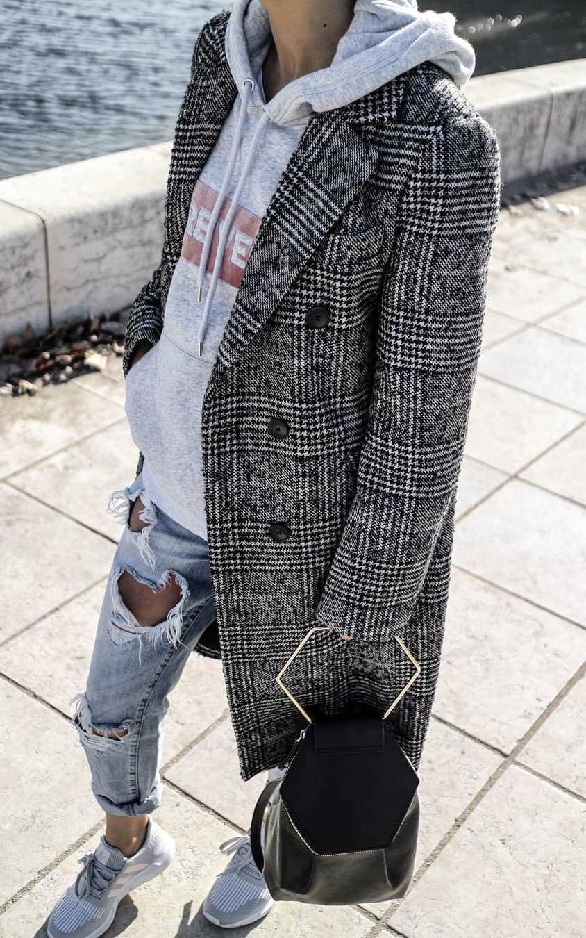 what to wear with a pair of ripped jeans : black bag + sneakers + plaid coat + grey sweashirt