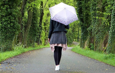 Woman Walking Down a Path, Alone, with Umbrella