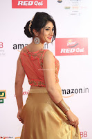 Harshika Ponnacha in orange blouuse brown skirt at Mirchi Music Awards South 2017 ~  Exclusive Celebrities Galleries 017.JPG