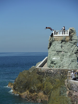 A cliff diver jumping in Mazatlan, Mexico