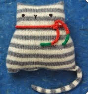 http://www.knit1-2-3.com/forthecause/patterns/sweetstripeykitty.pdf