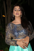 Nikki Galrani in Green Skirt  Top at Marakathamani music launch ~  Exclusive (86).JPG