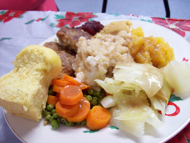 Vegetarian Christmas dinner with Gluten Steaks, dressing, mashed potatoes and vegetables.