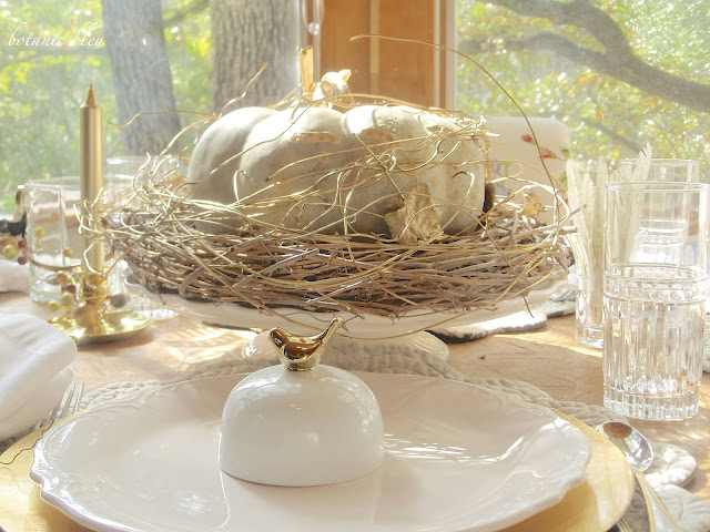 Thanksgiving gold and white table setting is a reminder of the abundance in our lives