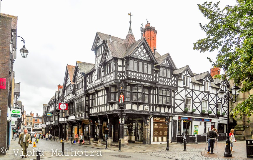 The first post about the coach trip to Llandudno and the North of Wales had one unexpected element - a stopover at the city of Chester, Cheshire. Chester isn't a part of Wales, it is in England. The town was anyways a much-required break during the long coach travel. We only had a couple of hours to explore the town so we set out as soon as we got off the coach. We started with a brief walk on most complete city walls in the UK. These walls pass along some of the most popular tourist attractions in Chester and offers some nice views. This was another view from the wall. However we couldn't walk on the walls for too long because we had to have lunch and also explore as much of town as possible during the couple of hours allotted to us. We knew we wouldn't be able to cover much, but just wanted to get a feel of the place. Chester is famous for its Tudor-style, Timber-framed, black-and-white buildings. We got a good look at these. I find this architecture very fascinating. Of course, the term tudor-style means much more than these buildings, but these are the most striking according to my naive opinion. We had lunch at one of the pubs housed in one such building. It was a completely different experience. And then it was time to head back to Newcastle. We weren't able to see the famous Chester Zoo, but one needs one complete day for that. And soon after boarding the bus, we were passing through rolling hills in different shades of green. I have skipped through several towns we covered during this trip. Will be talking about them soon. So watch out.