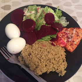 boiled eggs, salmon, salad, beetroot and cous cus