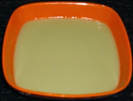jaggery dissolved in thick coconut milk - preparing pumpkin kheer