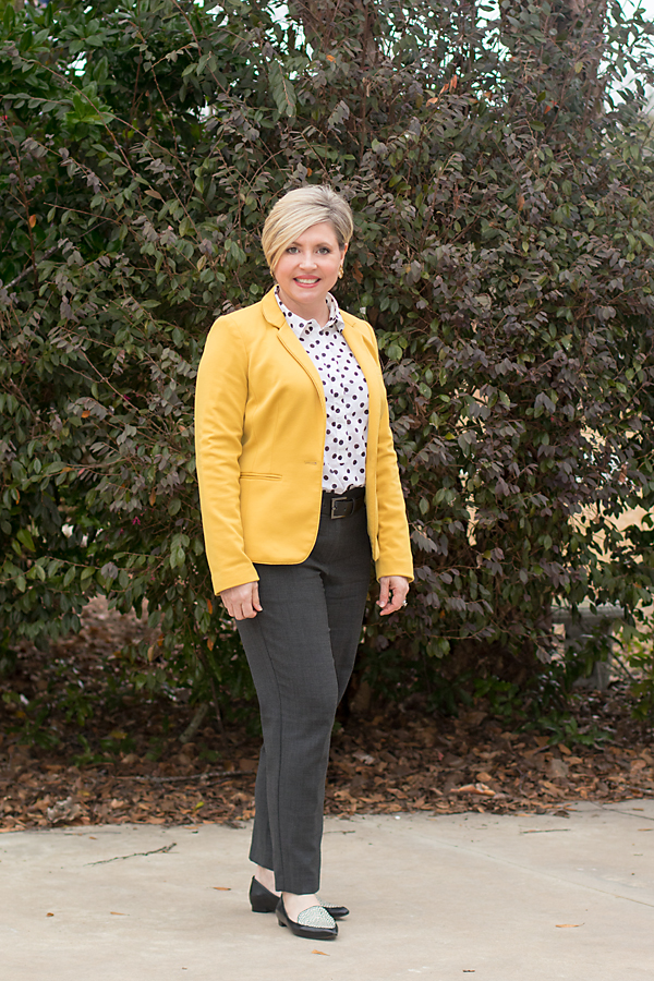 mustard blazer with black and white polka dot top and grey ankle pants