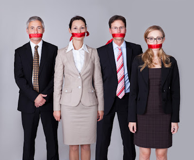 4 business people have red tape around their mouths