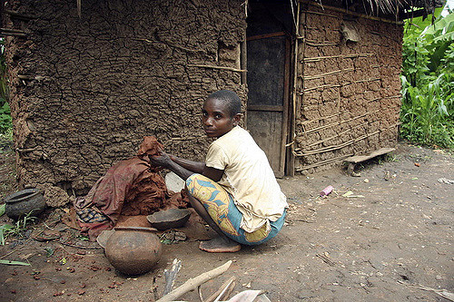 Batwa Woman Prepping Clay to Make Pots in Murwi, Burundi