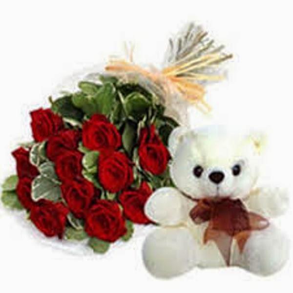 Wallpaper boneka beruang putih bawa bunga