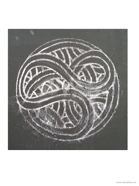 Paris street art chalk drawn Celtic motif circle