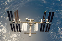 Earth and the International Space Station seen from Space Shuttle Discovery