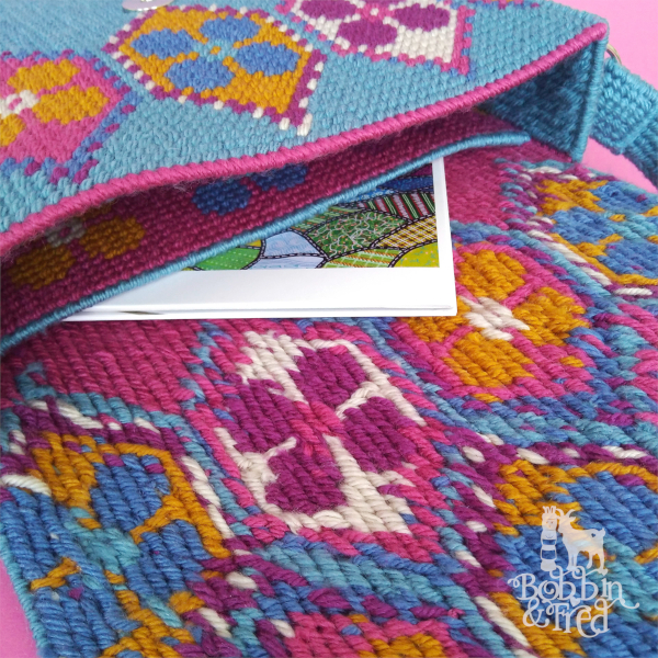 A look inside a needlepoint satchel by Bobbin and Fred