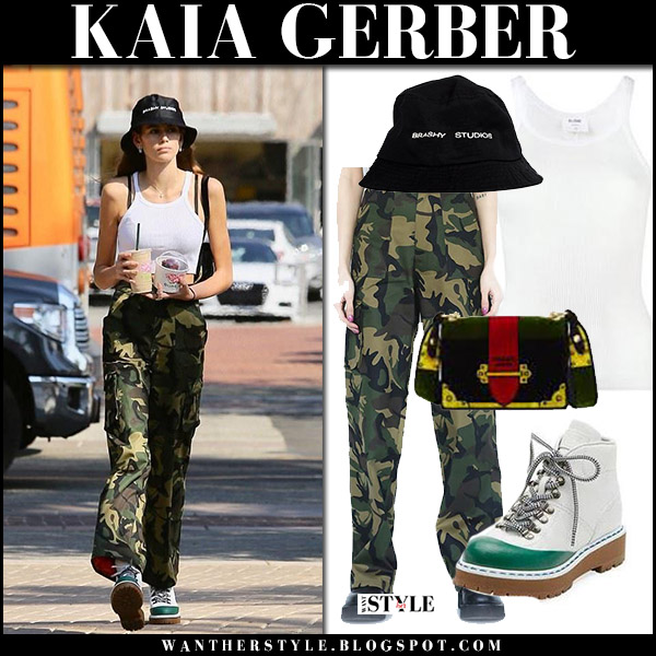 Kaia Gerber in white tank top, camo pants and white hiking boots prada model street style october 9 2017