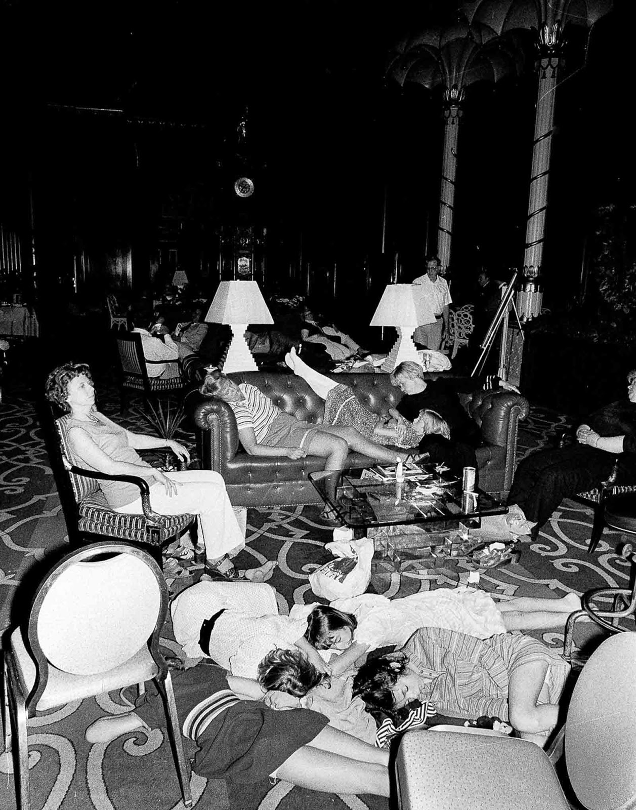Stranded people sleep in the lobby at the Waldorf-Astoria hotel.