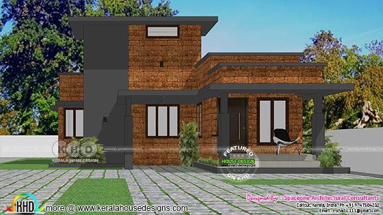 Laterite stone single floor flat roof house