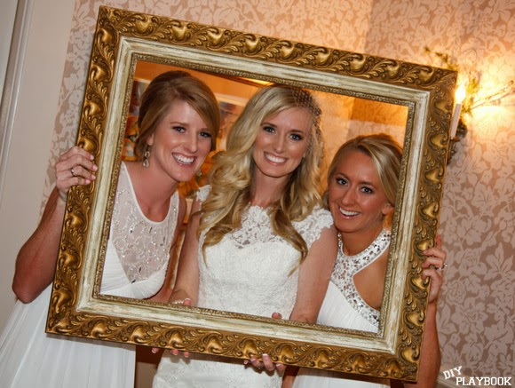 The bride, Bridget, has a bright smile for her big day alongside two bridesmaids.