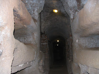 Grave niches were carved out of the rock in the  passageways of the Roman catacombs