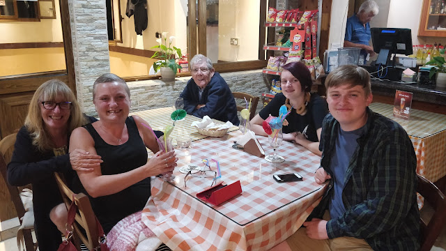 madmumof7 and family in taverna in Cyprus