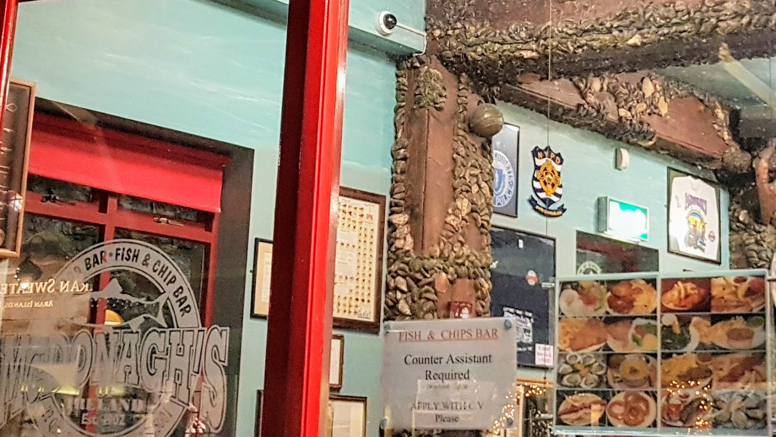 view into a fish and chip shop with fake barnacle-encrusted beams